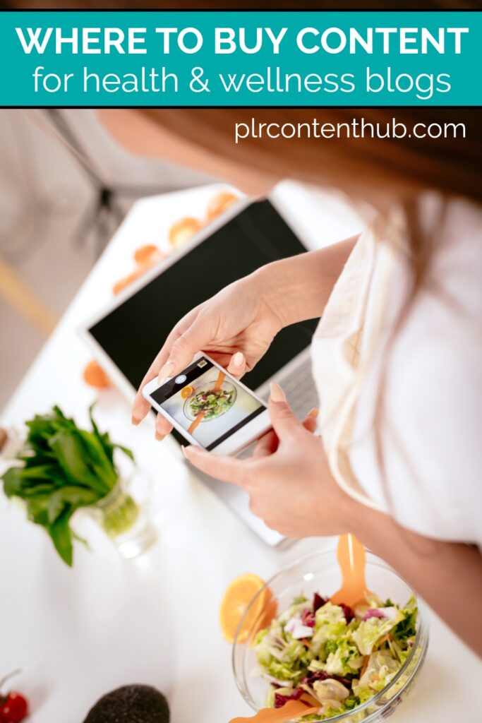 Woman holding a cell phone taking food pictures for her blog